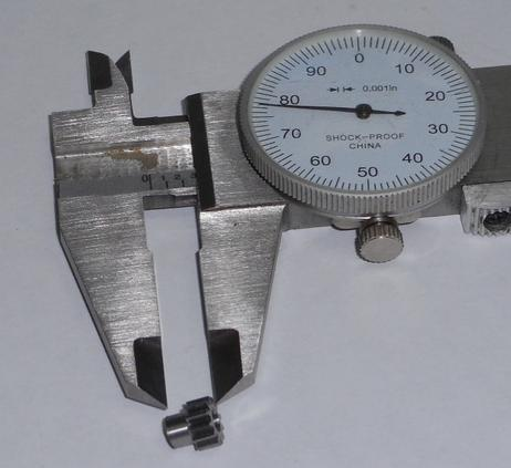 gear being measured by calipers
